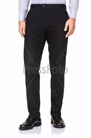 Понятие моды с брюками на белом фоне