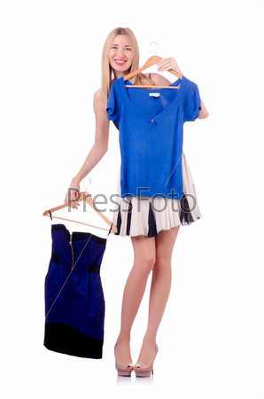 Фотография на тему Женщина меряет новую одежду на белом фоне
