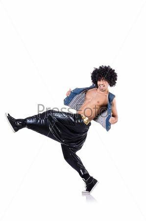 Фотография на тему Танцор в стиле рэп в широких штанах на белом фоне