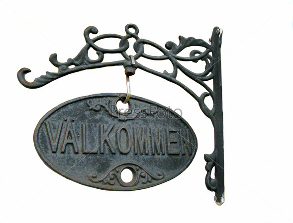 Металлическая пластина с словами «Добро пожаловать» на шведском языке