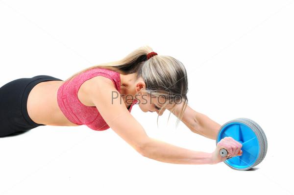 Фотография на тему Красивая молодая женщина делает упражнения на полу для укрепления мышц, студийный портрет на белом фоне