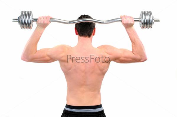 Фотография на тему Молодой парень делает упражнения со штангой, изолированный на белом фоне