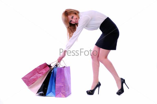 Фотография на тему Красивая женщина с пакетами на белом фоне