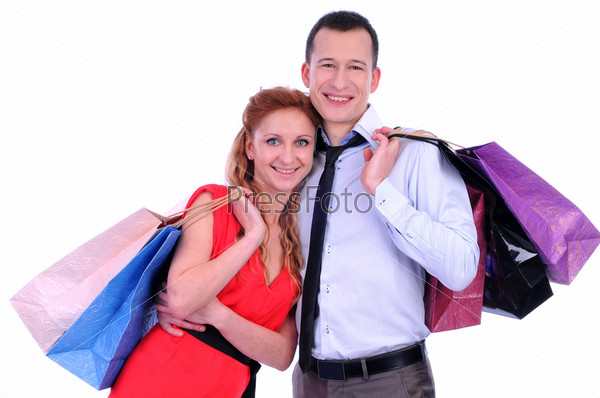 Фотография на тему Мужчина и женщина с цветными пакетами