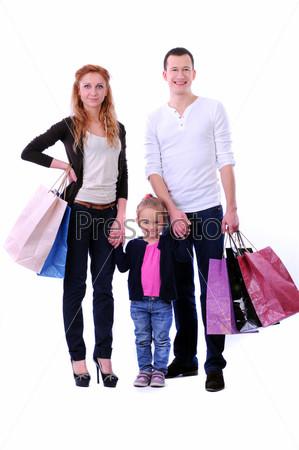 Родители с ребенком и покупками на белом фоне