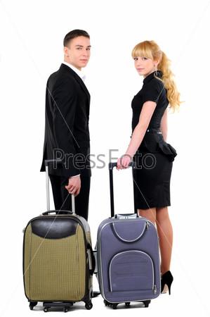 Двое деловых людей готовятся к командировке, изолированные на белом фоне