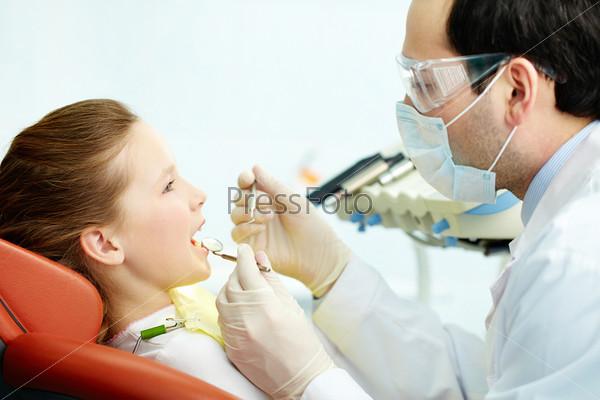 Обследование зубов