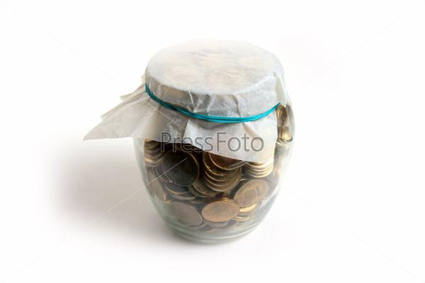 Российские рубли в стеклянной банке, накопление и экономия денег