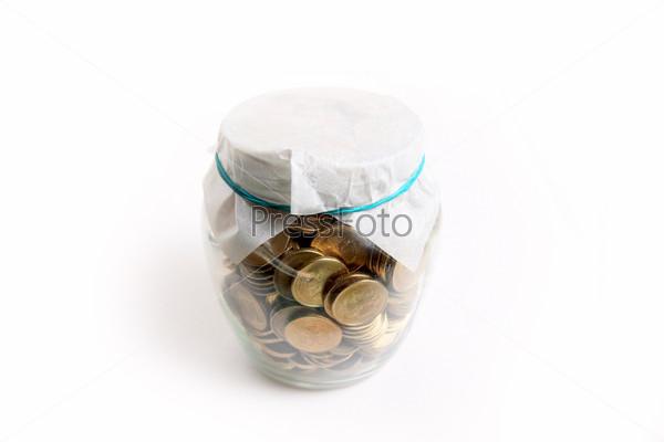 Российские рубли в стеклянной банке, накопление и экономия