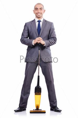 Бизнесмен с пылесосом на белом фоне