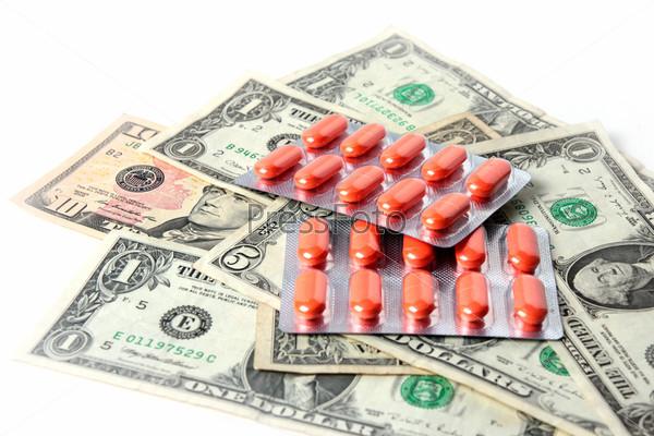 Фотография на тему Упаковка таблеток и доллары как элемент медицинских услуг