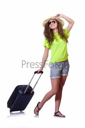 Молодая женщина с чемоданом на белом
