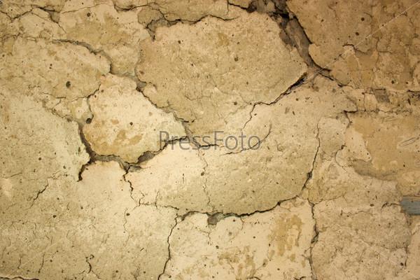 Текстуа потрескавшейся старой глиняной стены