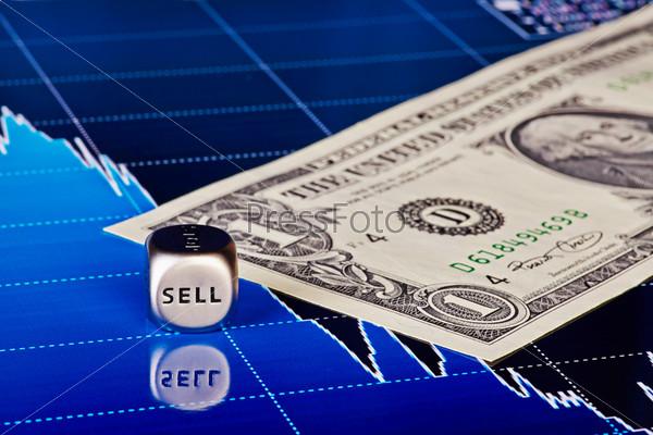Фотография на тему Кубик со словом продажа, один доллар и диаграмма как фон