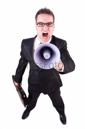Молодой бизнесмен с громкоговорителем на белом фоне