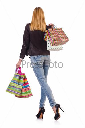 Фотография на тему Молодая женщина с пакетами после шоппинга