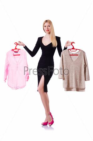 Фотография на тему Женщина пытается выбрать платье на белом фоне