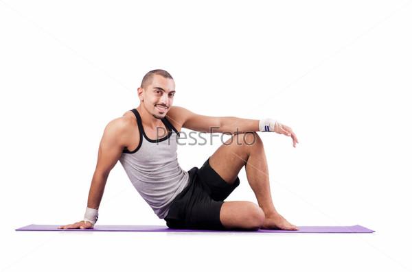 Фотография на тему Мужчина делает упражнения на белом