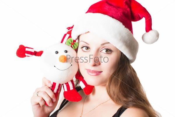 Портрет женщины в шапке Санты со снеговиком на белом фоне. Концепция праздника и Рождества
