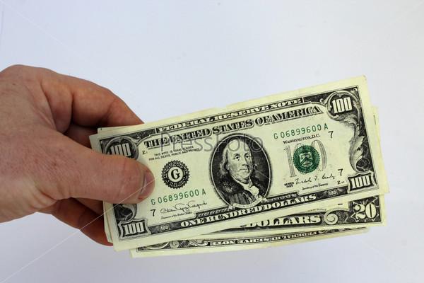 Фотография на тему Доллары США, изолированные на белом фоне