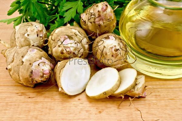 Фотография на тему Резанный топинамбур с маслом на доске