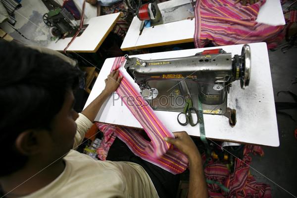 Фотография на тему Работник текстильной фабрики
