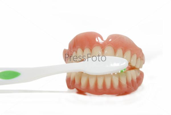 Фотография на тему Вставные зубы и зубная щетка