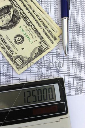 Фотография на тему Стодолларовые банкноты, калькулятор и ручка