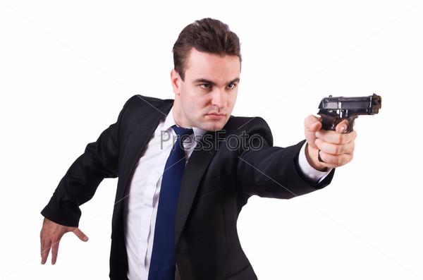 Бизнесмен с пистолетом, изолированный на белом фоне
