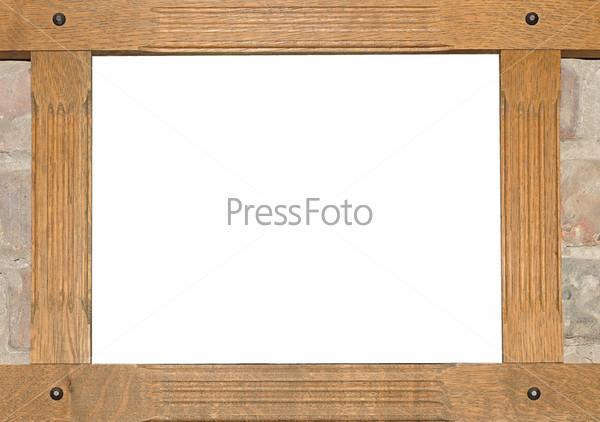 Старая деревянная рамка на кирпичной стене