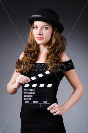 Фотография на тему Женщина с кино-хлопушкой