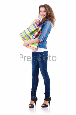 Фотография на тему Молодая женщина с покупками в пакетах