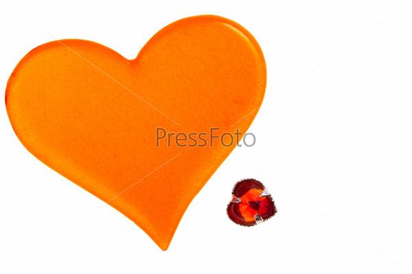 Фотография на тему Большое оранжевое пластиковое сердца и красное стеклянное сердечко