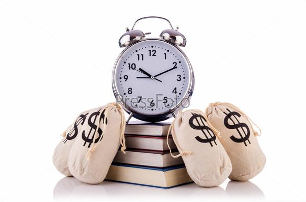 Фотография на тему Мешки денег и будильник на белом фоне