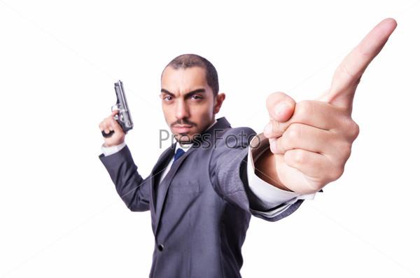 Бизнесмен с пистолетом, изолированный на белом