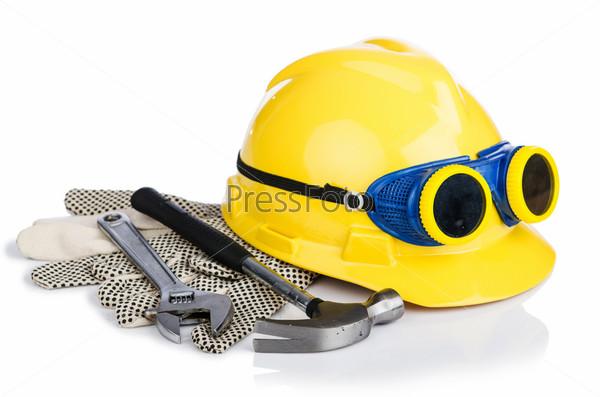 Фотография на тему Шлем и инструменты, изолированные на белом