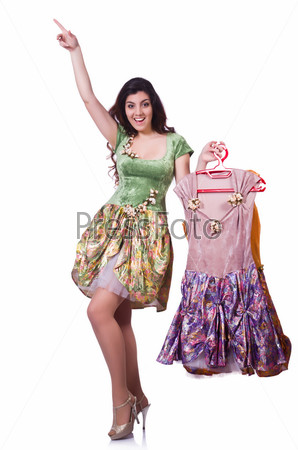 Фотография на тему Женщина выбирает платье на белом фоне