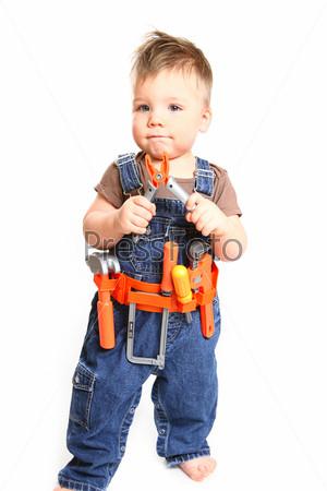 Фотография на тему Маленький мальчик с инструментами на белом фоне