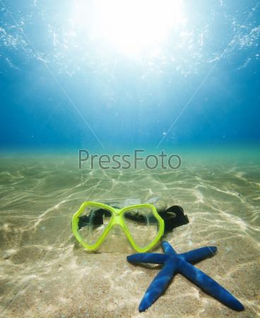 Подводная маска и морская звезда