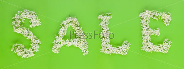 """Фотография на тему Знак """"распродажа"""" из цветов вишневого дерева"""