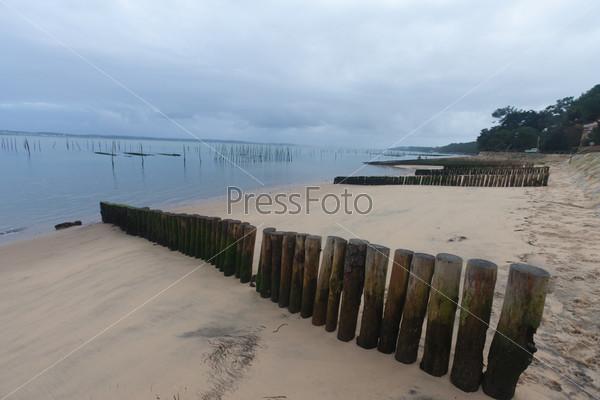 Фотография на тему Забор на песке