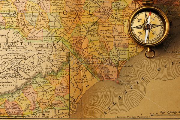 Фотография на тему Античный компас над старой карте XIX века