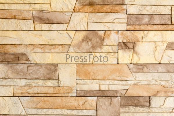 Фотография на тему Фрагмент стены облицованной плиткой, имитирующей природный камень