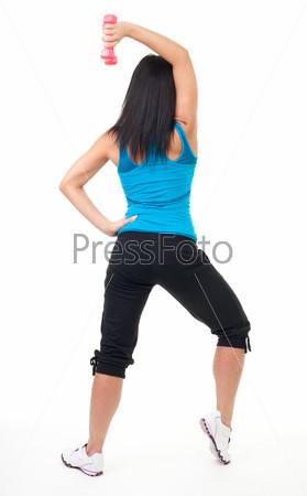 Фотография на тему Женщина делает упражнения с гантелями