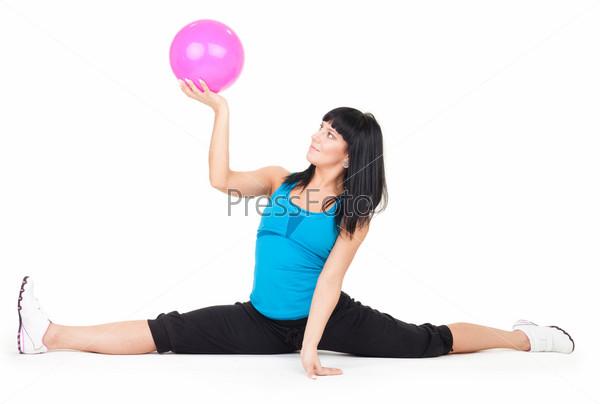 Фотография на тему Женщина делает упражнения с мячом
