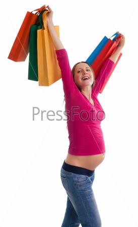 Беременная женщина с покупками