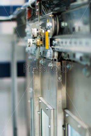 Фотография на тему Абстрактный фон с механизмом двери лифта