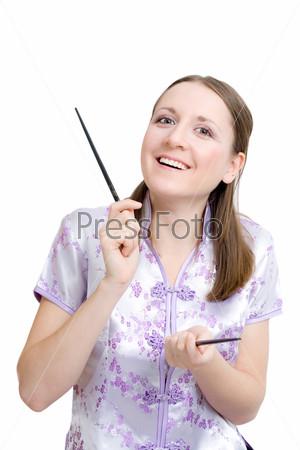 Фотография на тему Женщина с палочками для суши