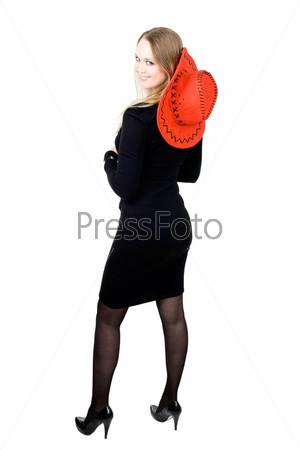 Блондинка в красной ковбойской шляпе на белом фоне