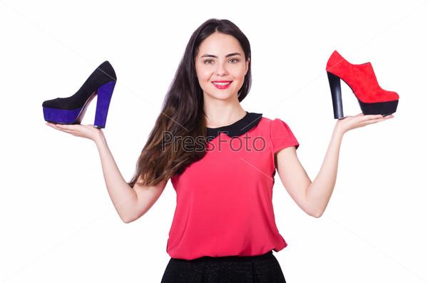 Фотография на тему Молодая женщина с выбором обуви на белом фоне